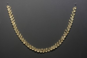 "Golden necklace made of tesserae in the shape of rosettes and lily-papyrus flowers. From  the Mycenaean Tholos tomb at the site ""Kazanaki"" of Volos, 1500-1300 BC. The tomb was discovered in 2004, while building the ring road of Volos."
