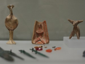 "Clay figurines; enthroned male, ""Phi"" type female, animal. Late Bronze Age (Mycenaean period) 15th-12th century BC."
